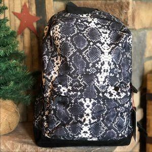Handbags - NWT mojo snakeskin backpack